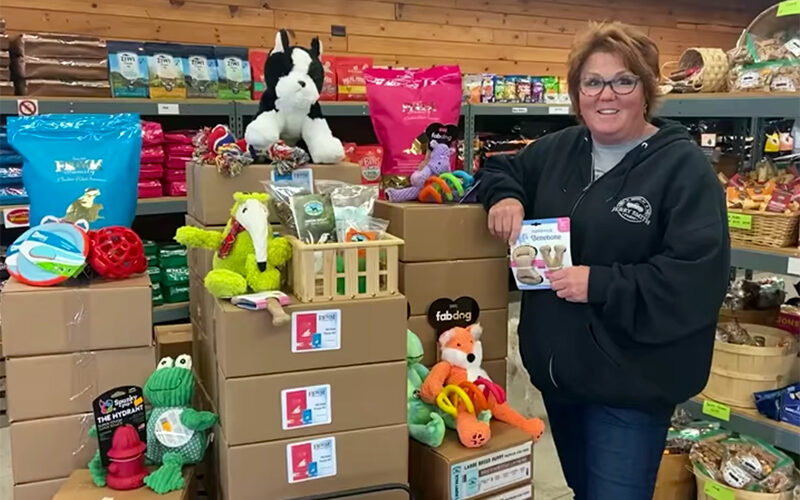 Amy Smith with Puppy Kits at Feed and Seed Station