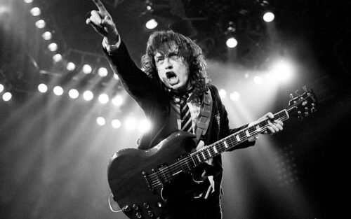 angus young of acdc points to audience wallpaper   1280x800