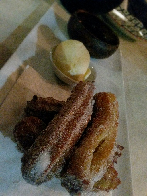 Churros with vanilla bean ice cream and Valrhona chocolate sauce.