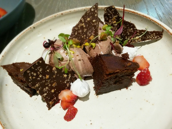 Cacao and coconut mousse with warm brownie and nut bark.