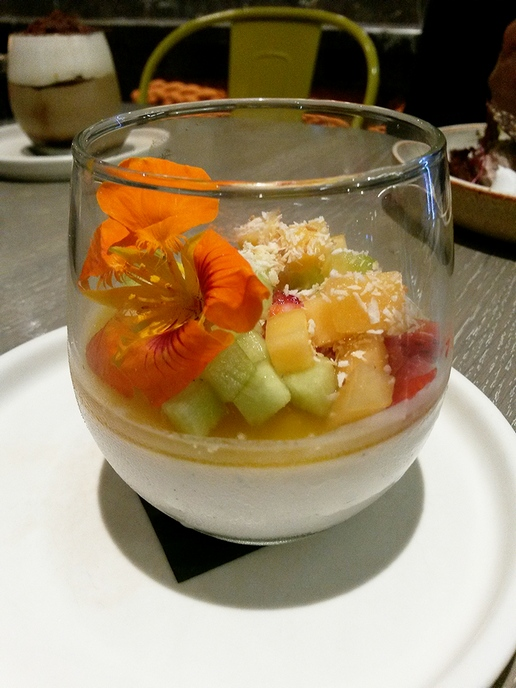 Coconut panna cotta with seasonal fruits.