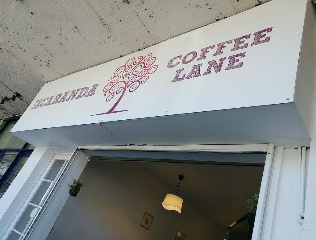 jacaranda coffee lane sign