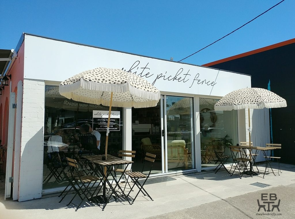 white picket fence cafe front
