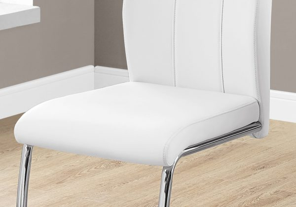 """Two 77.5"""" Leather Look, Chrome Metal, and Foam Dining Chairs"""