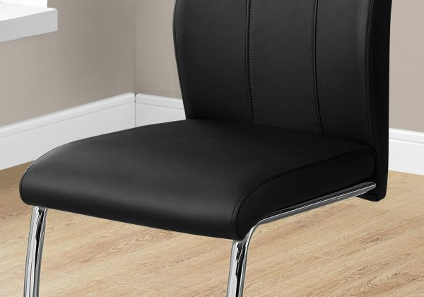 """Two 77.5"""" Black Leather Look, Chrome Metal, and Foam Dining Chairs"""
