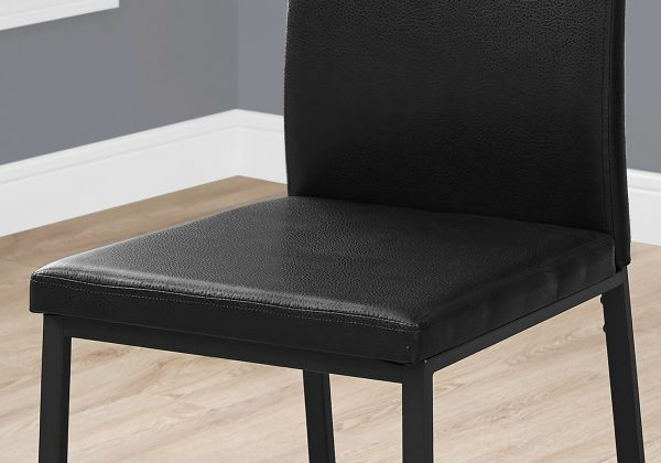 """Two 38"""" Black Leather Look, Foam, and Metal Dining Chairs"""