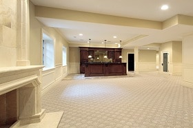 Basement in new construction home with stone fireplace