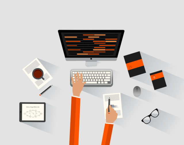 A software engineer programming at the desk – Programmer and dev