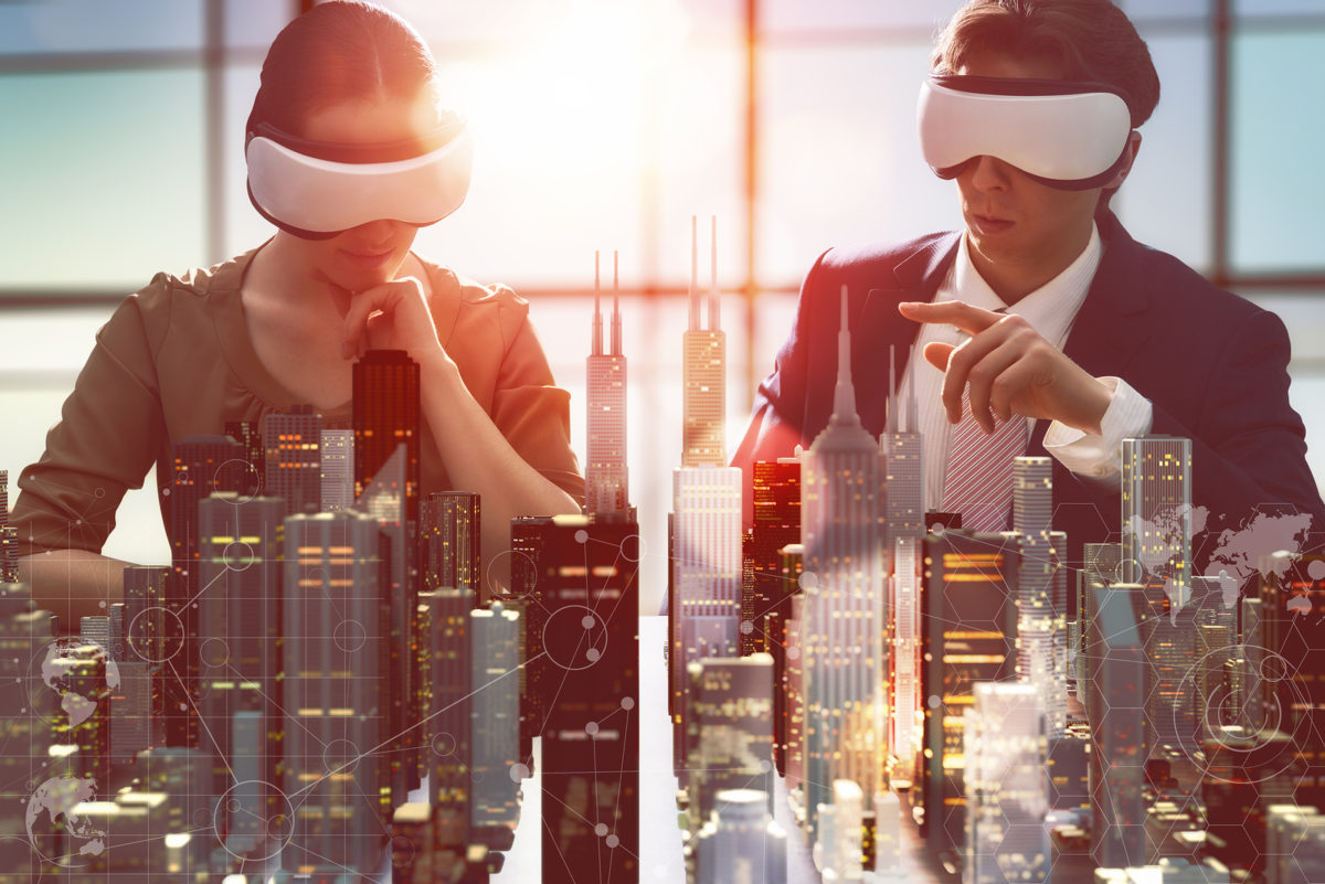 two business persons are developing a project using virtual real