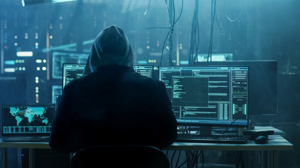 dangerous-hooded-hacker-breaks-into-government-data-servers-and-a-picture-id817486228 (1)