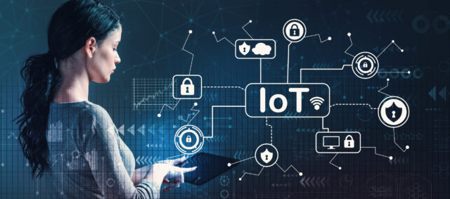 IoT security theme with woman using a tablet