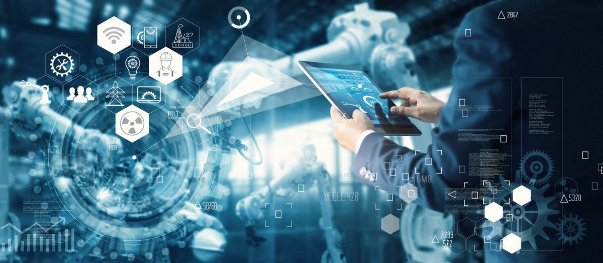 Manager Technician Industrial Engineer working and control robotics with monitoring system software and icon industry network connection on tablet. AI, Artificial Intelligence, Automation robot arm machine in smart factory on blue digital background, Inno