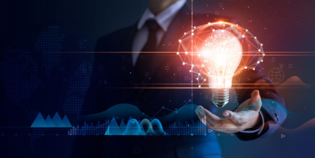 Businessman holding light bulb and brain network with icon business and technology, innovative in futuristic, network connection on virtual interface background, abstract, innovation and business technologies concept.