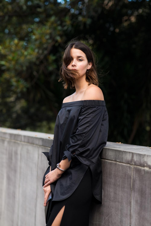 black tibi off the shoulder top and black skirt