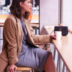 camel coat and grey midi dress