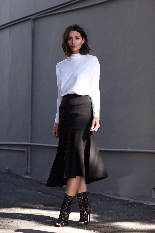 black skirt white turtle neck top