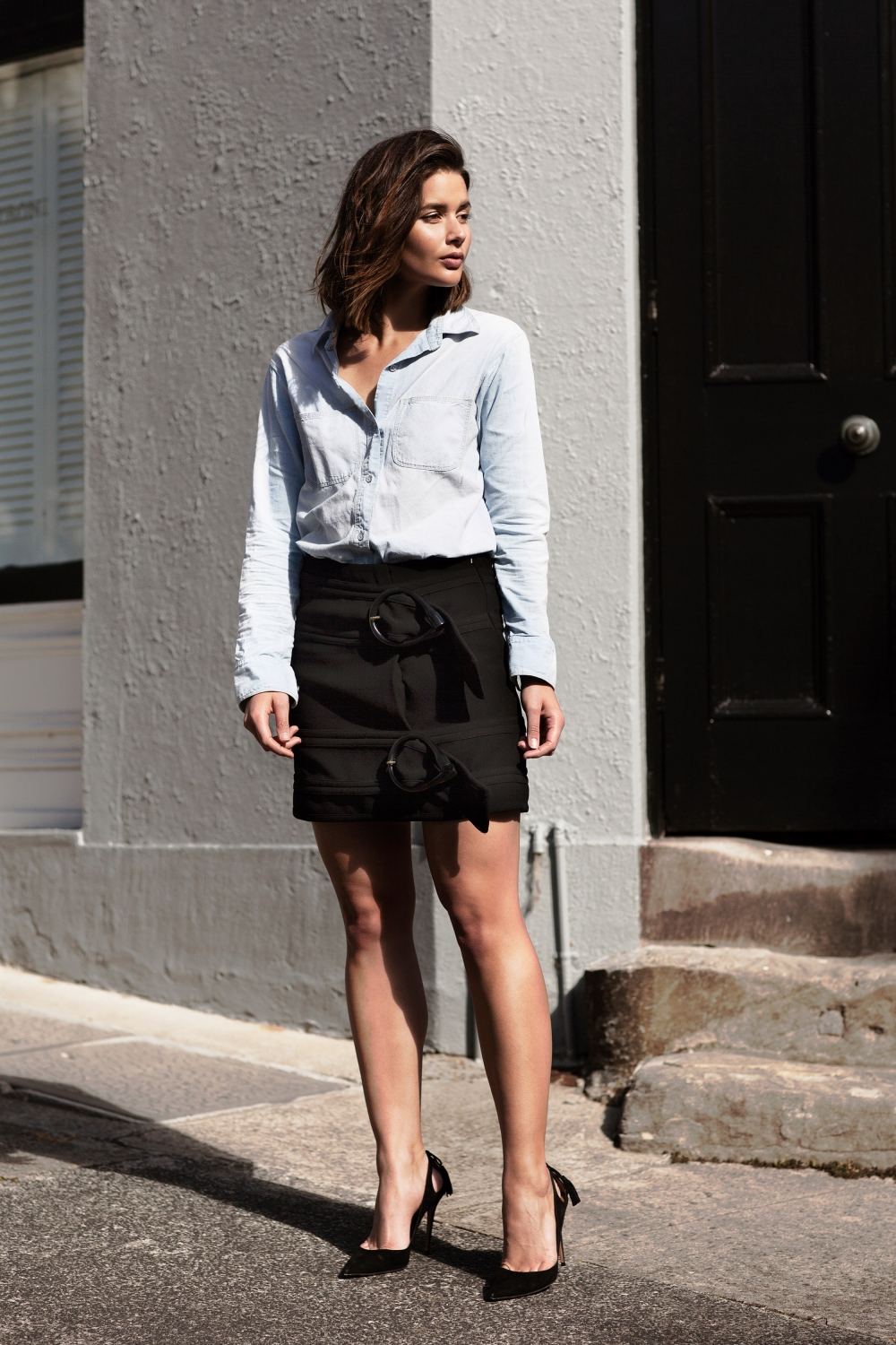 black j.w. Anderson mini skirt and denim shirt with Aquazzura black pumps