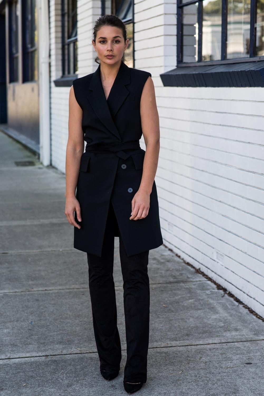 harper and harley wearing black on black. Black slightly flared pants and black vest