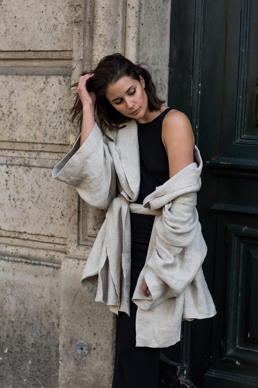 harper and harley wears bassike drape jacket and dion lee black dress