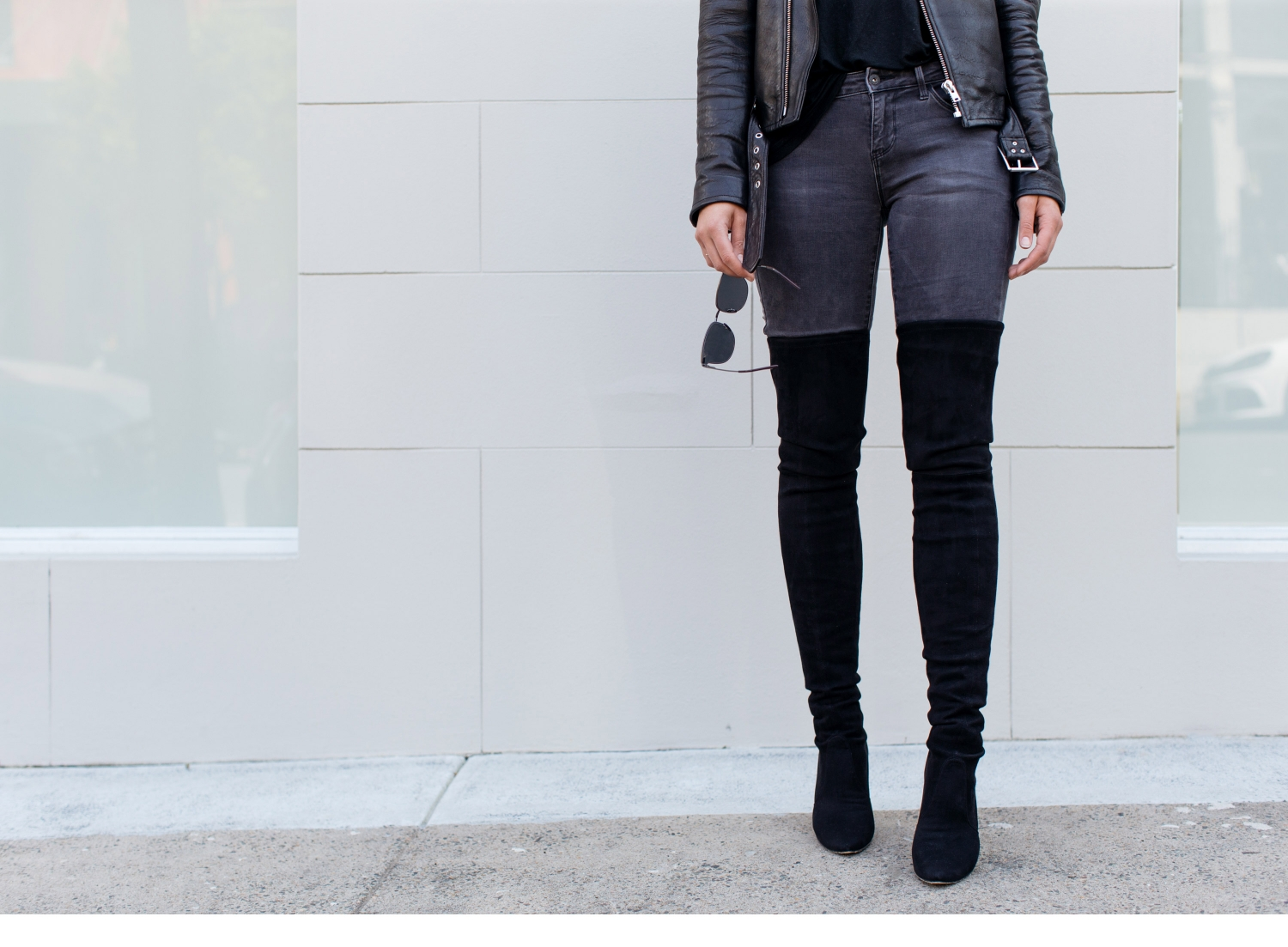 black leather jacket, grey jeans, black over the knee stuart weitzman boots, Sara Donaldson street style | Harper and Harley
