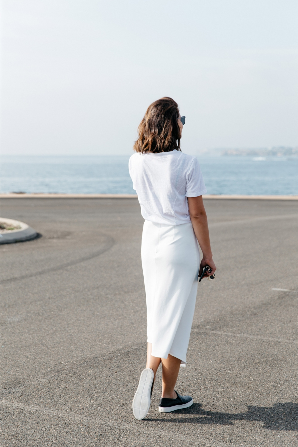 all white casual outfit wearing stuart weitzman