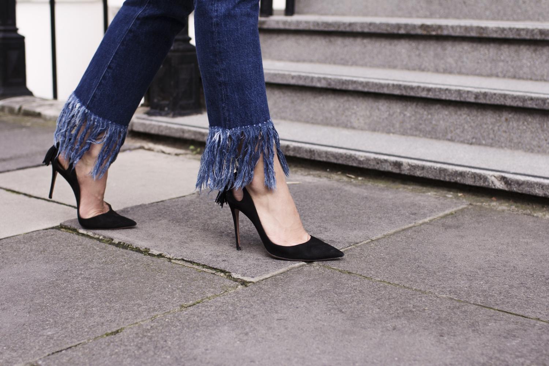 fringe denim jeans and black blazer
