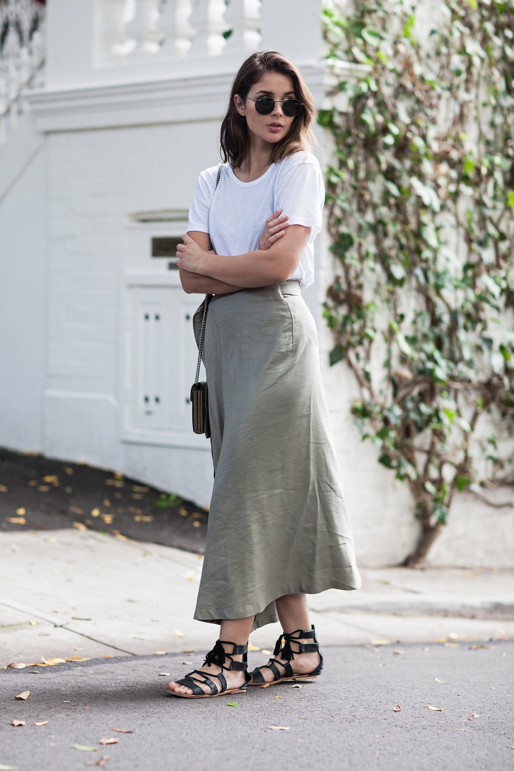 Khaki skirt and white t-shirt outfit