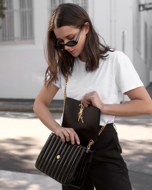 Saint Laurent Vicky Bag in black patent from Selfridges   looking inside designer bag   HarperandHarley