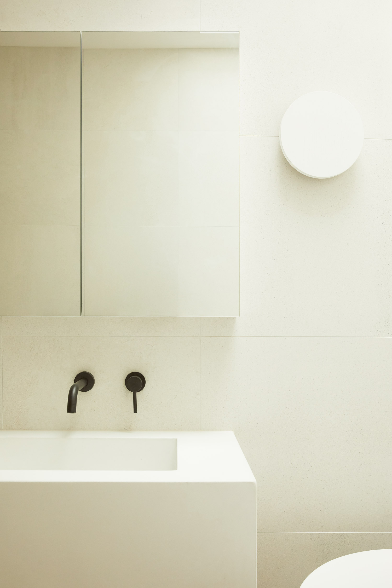 White Concrete sinks, black matte tapware, Warm minimalist bathroom in Sydney