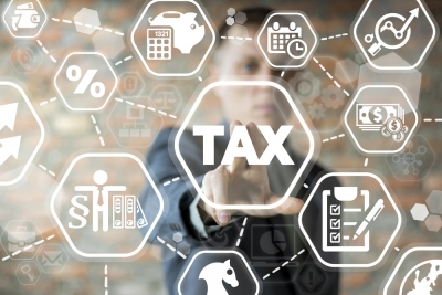 Man points at electronic board which says Tax - A representational image for Making Tax Digital