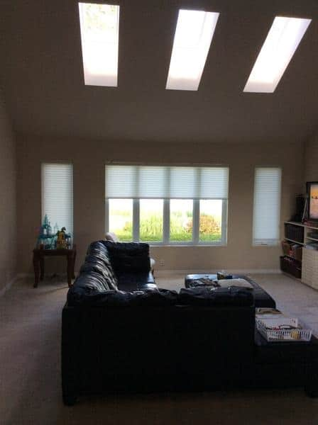 Dark room with a window leading outside