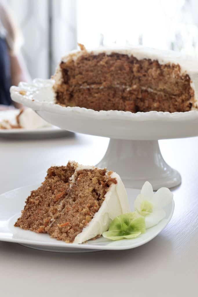 A slice of cake on a white plate