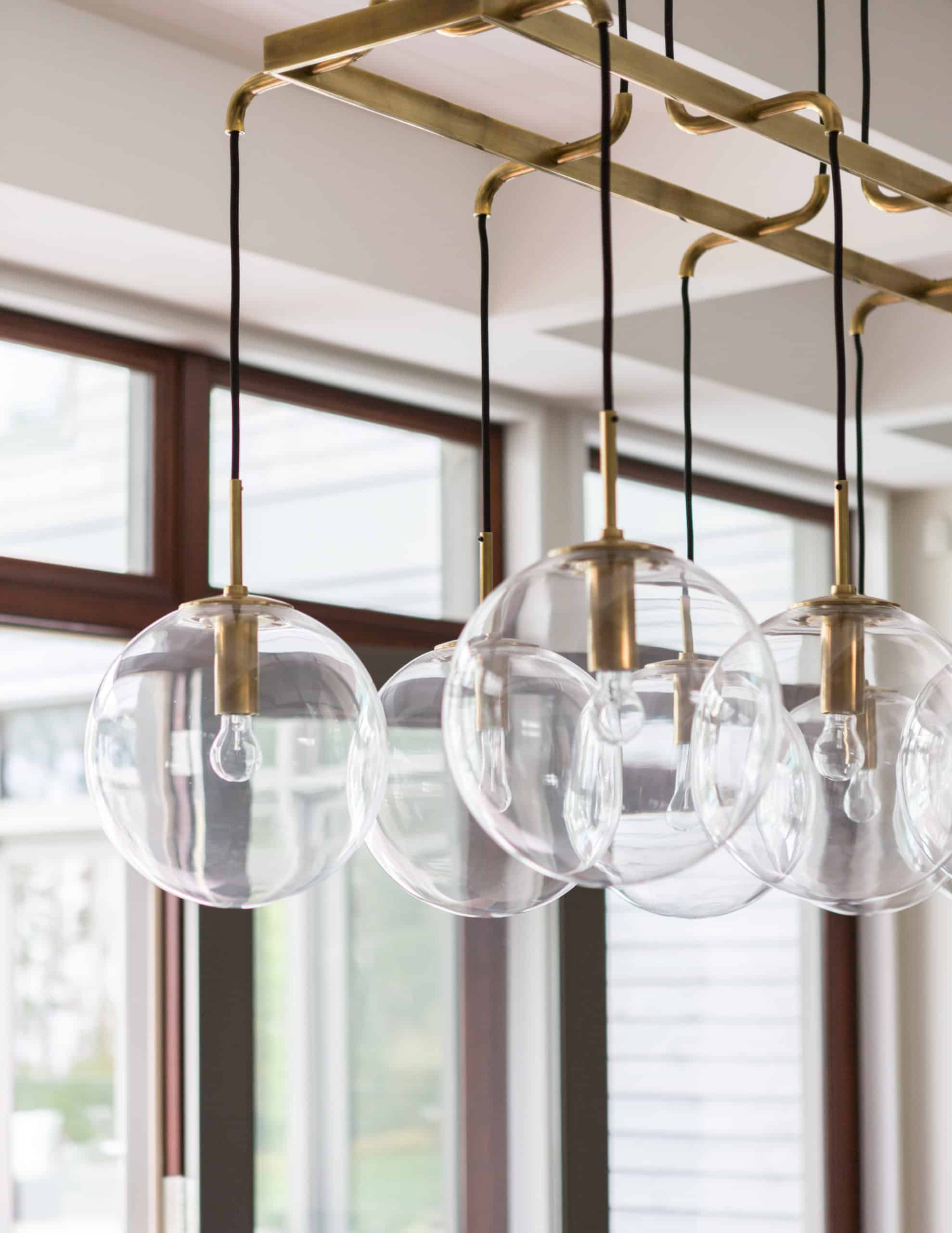 Globe lighting above a dining table.