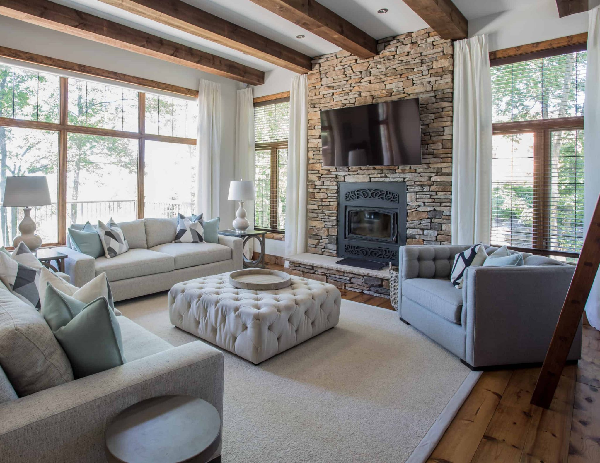 Modern living room with a television on the stone fi