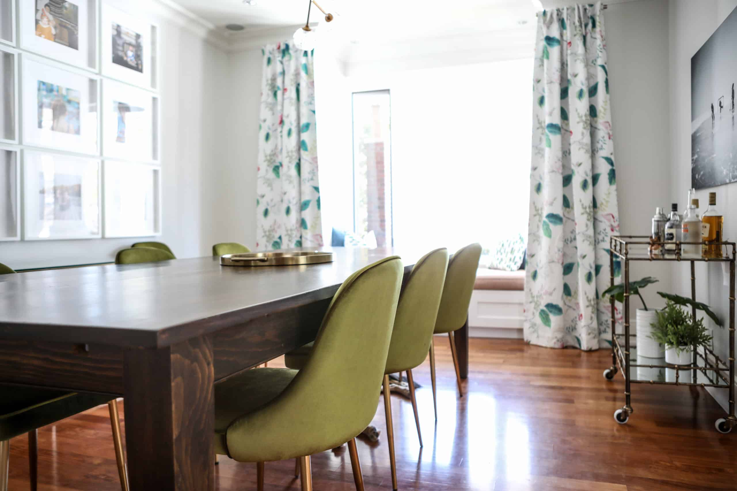 Dining room with green chairs at the table