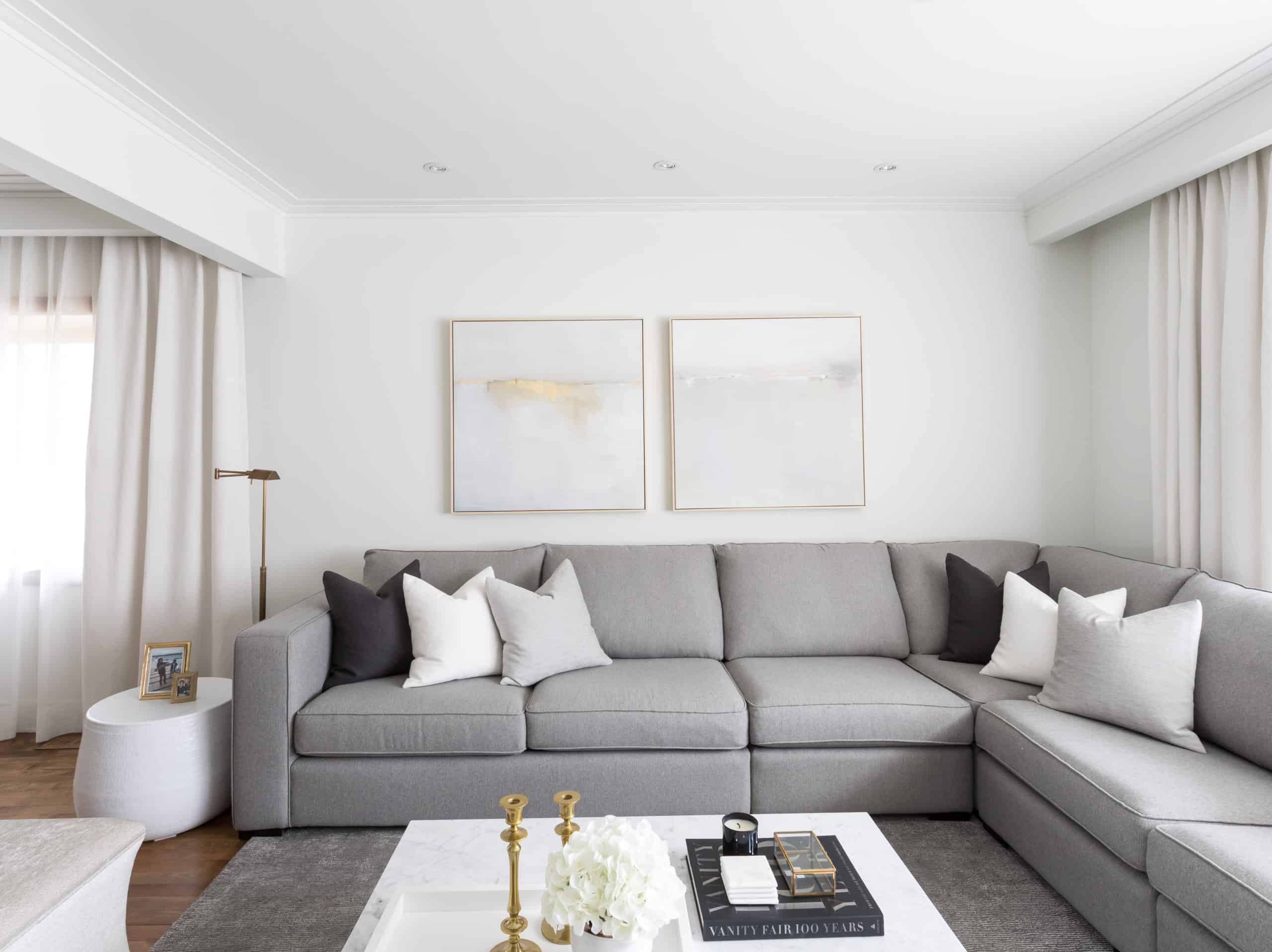 Large, gray corner couch in the corner of the living room