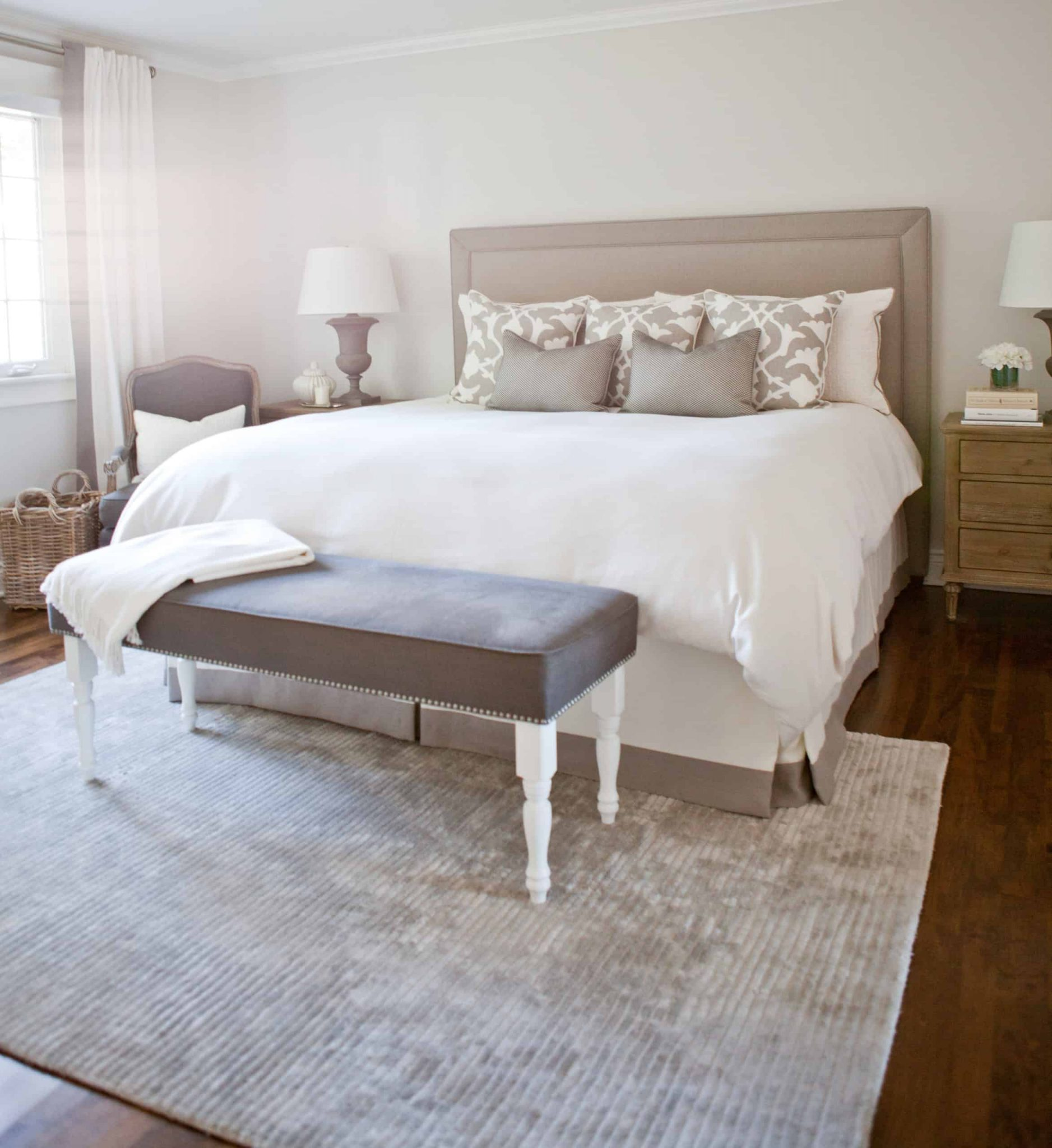 Brown bench at the end of the bed