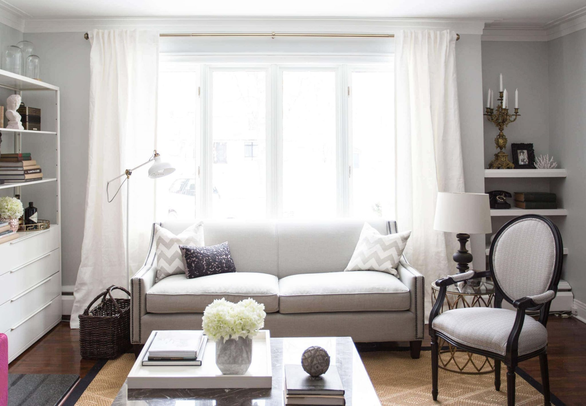 White couch against a large, bright window