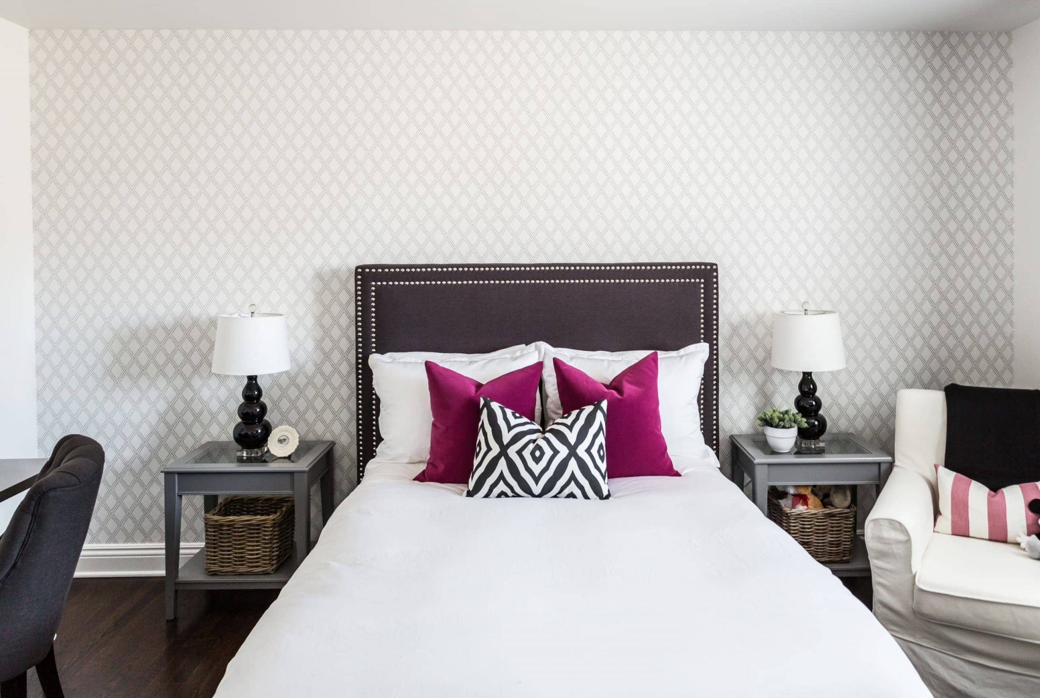 White bed withing a bedroom with bedside tables on each side