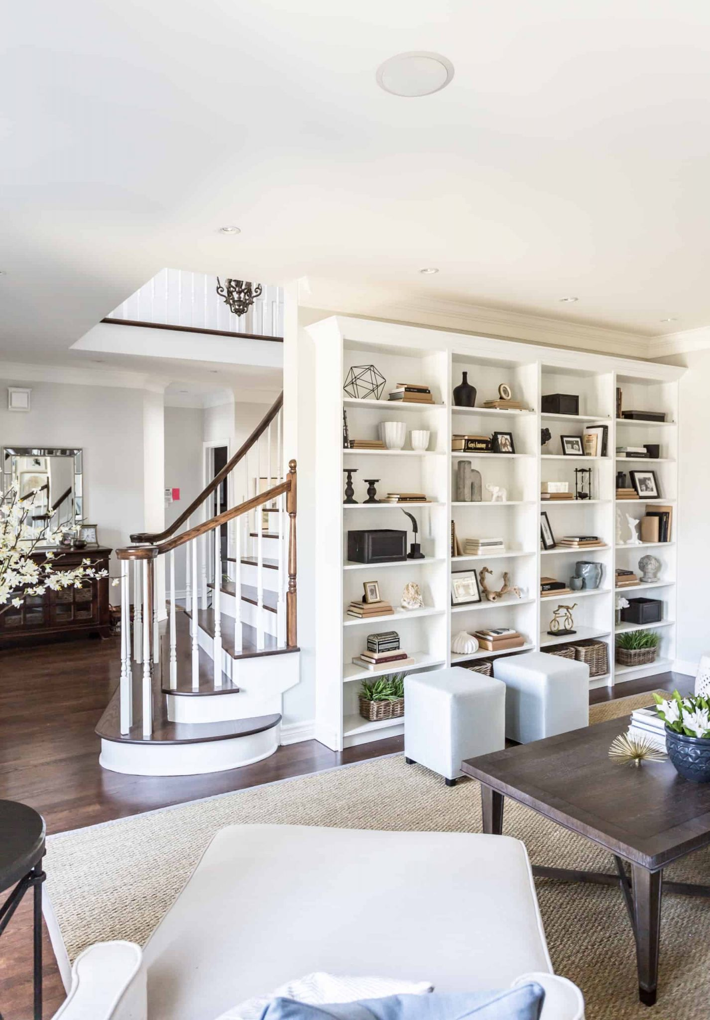 Wall covered in bookcases inside the living room