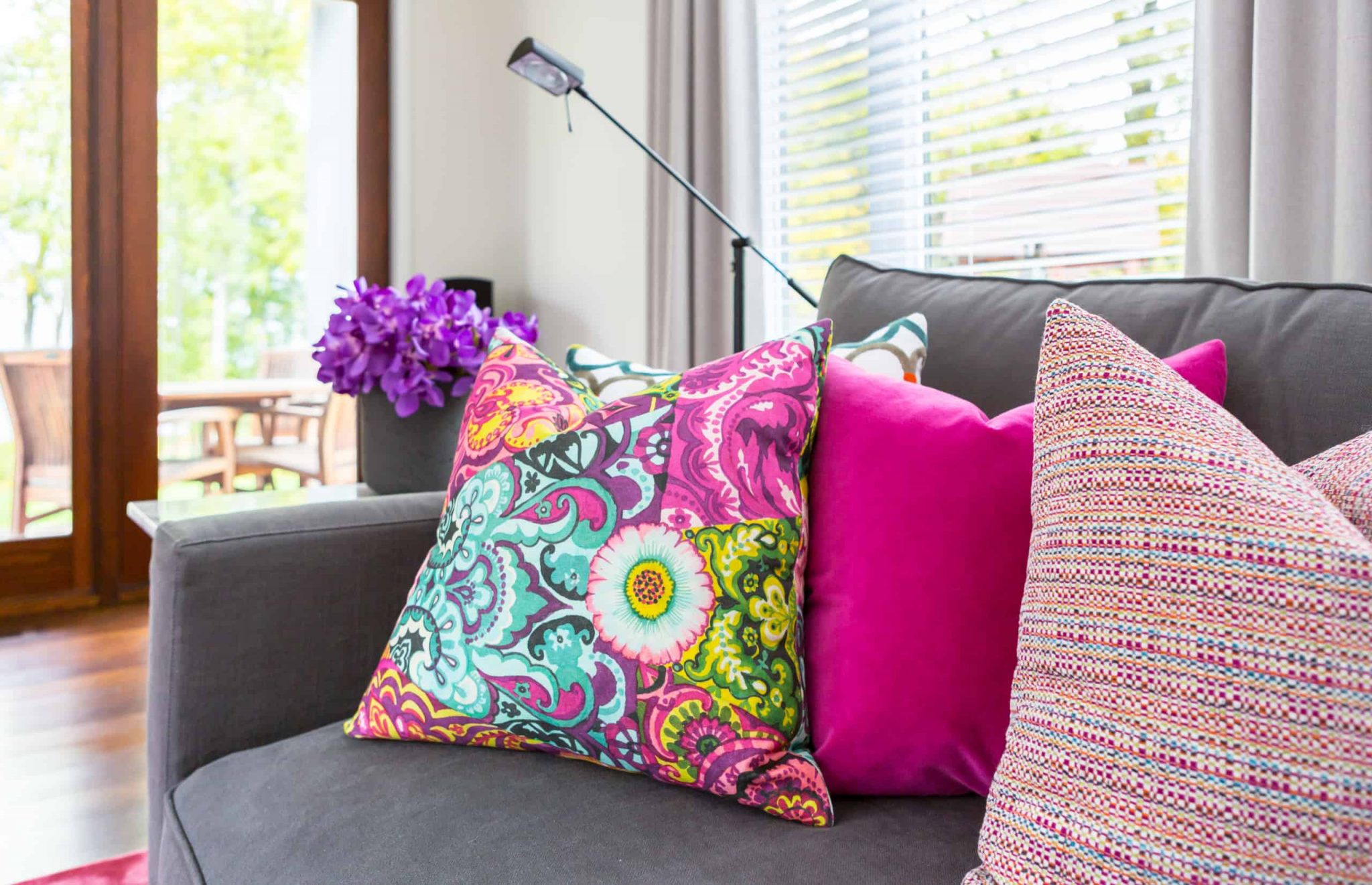 Colorful pillows on a dark gay couch