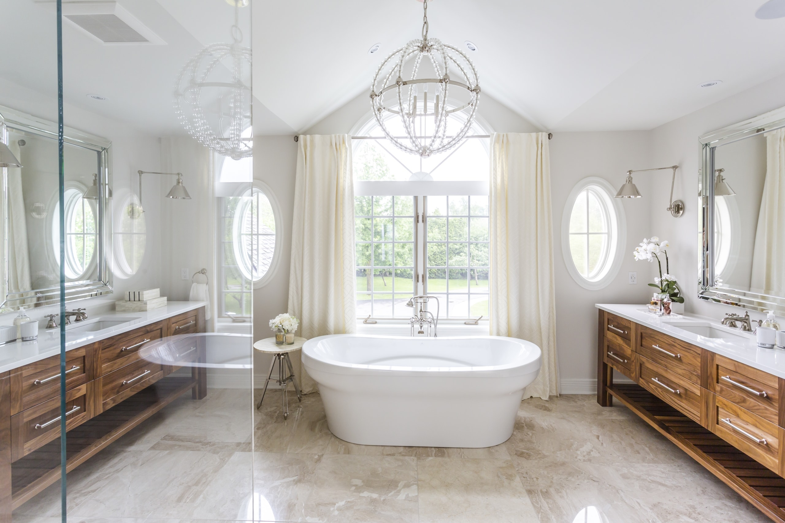 Bathroom with double vanities and soaker tub