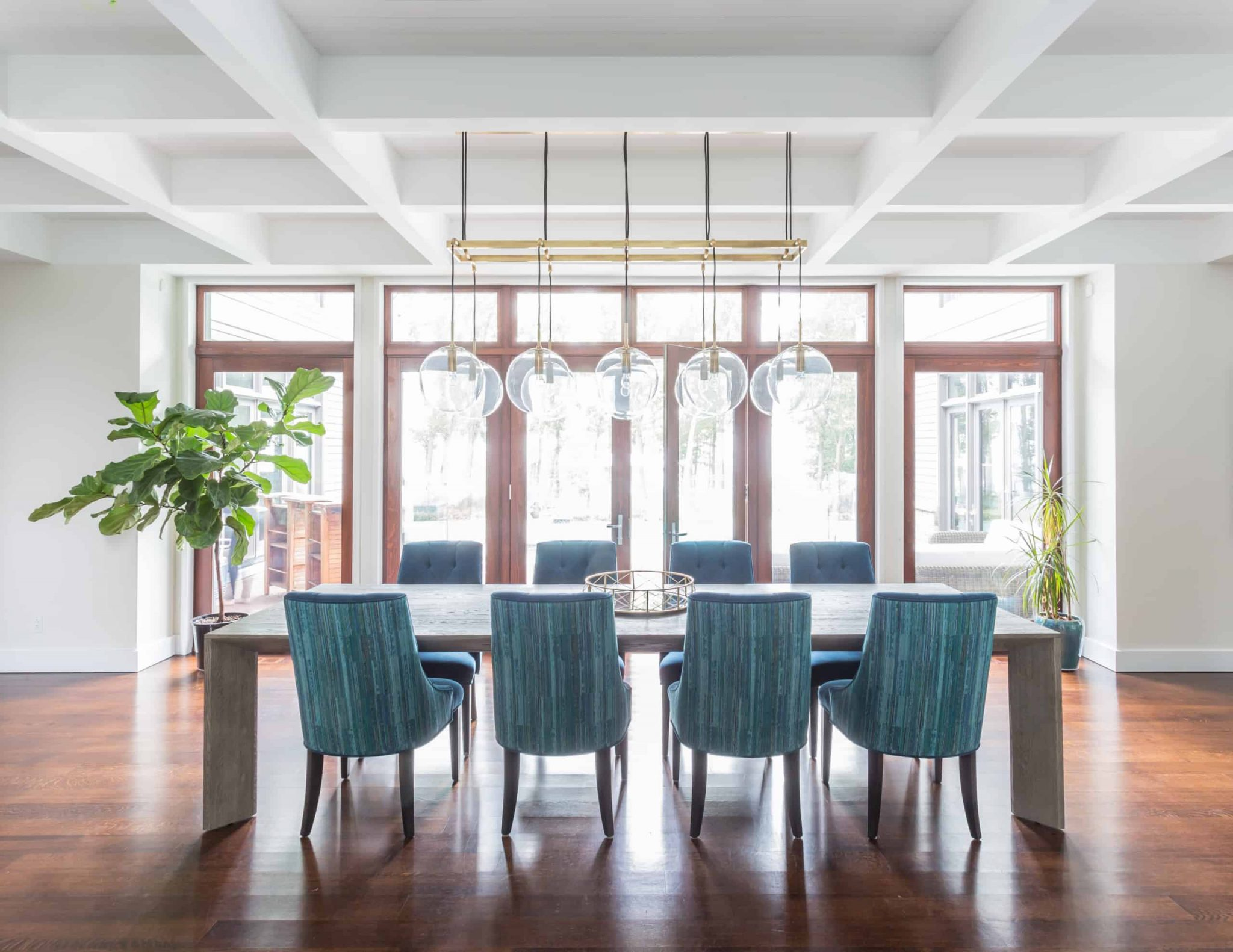 Massive dining room with blue chairs at the table