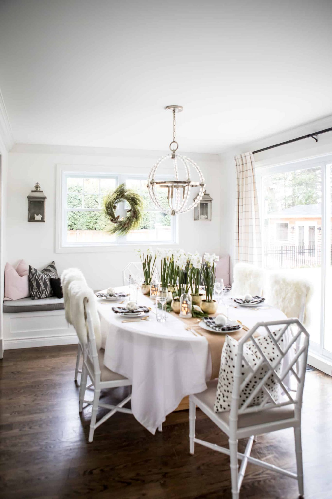 Modern dining room containing flowers in the middle of the table