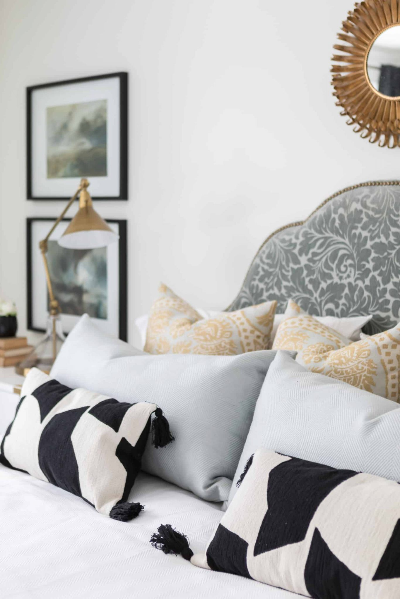 Array of pillows on a large bed