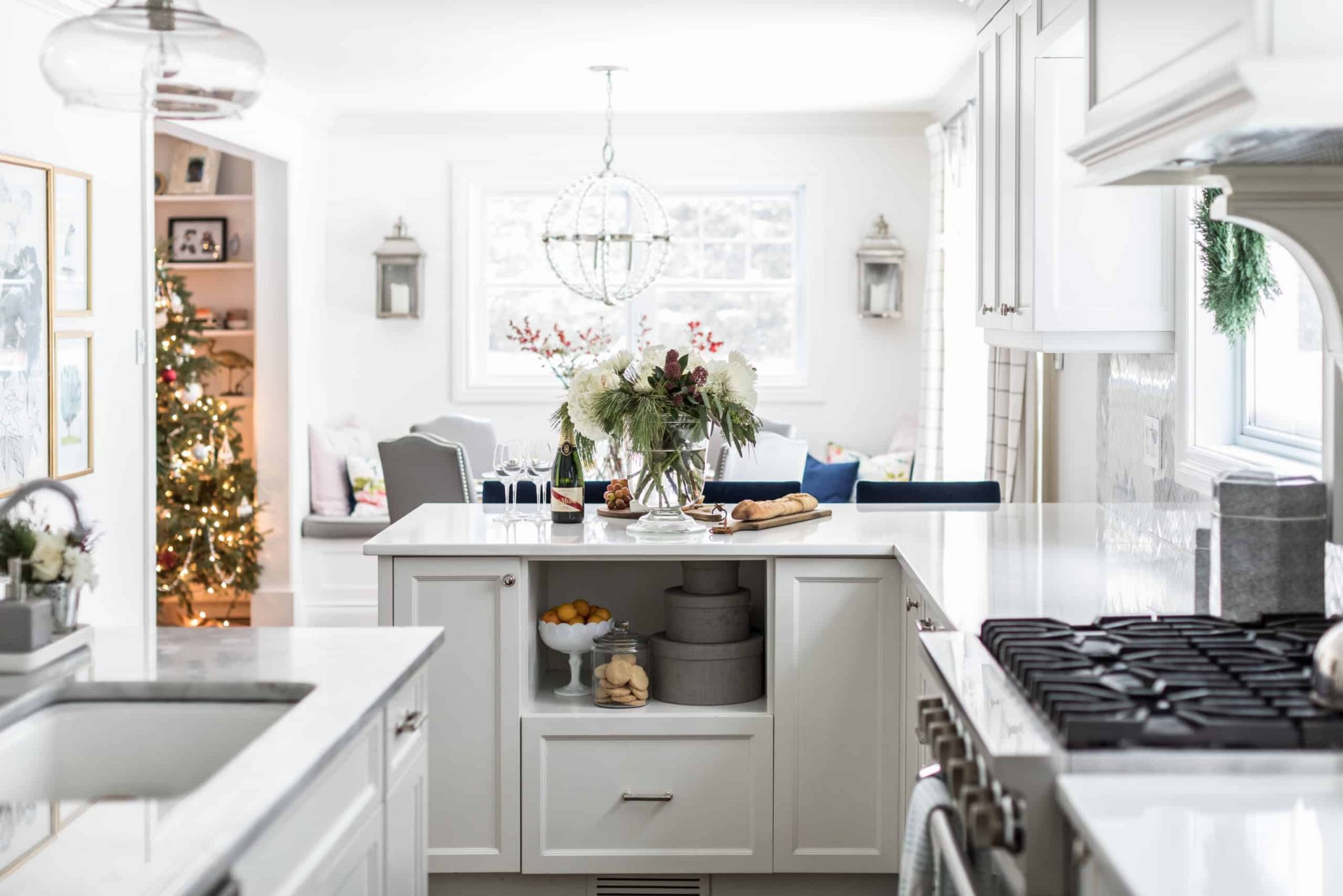 White, modern living room decorated for Christmas
