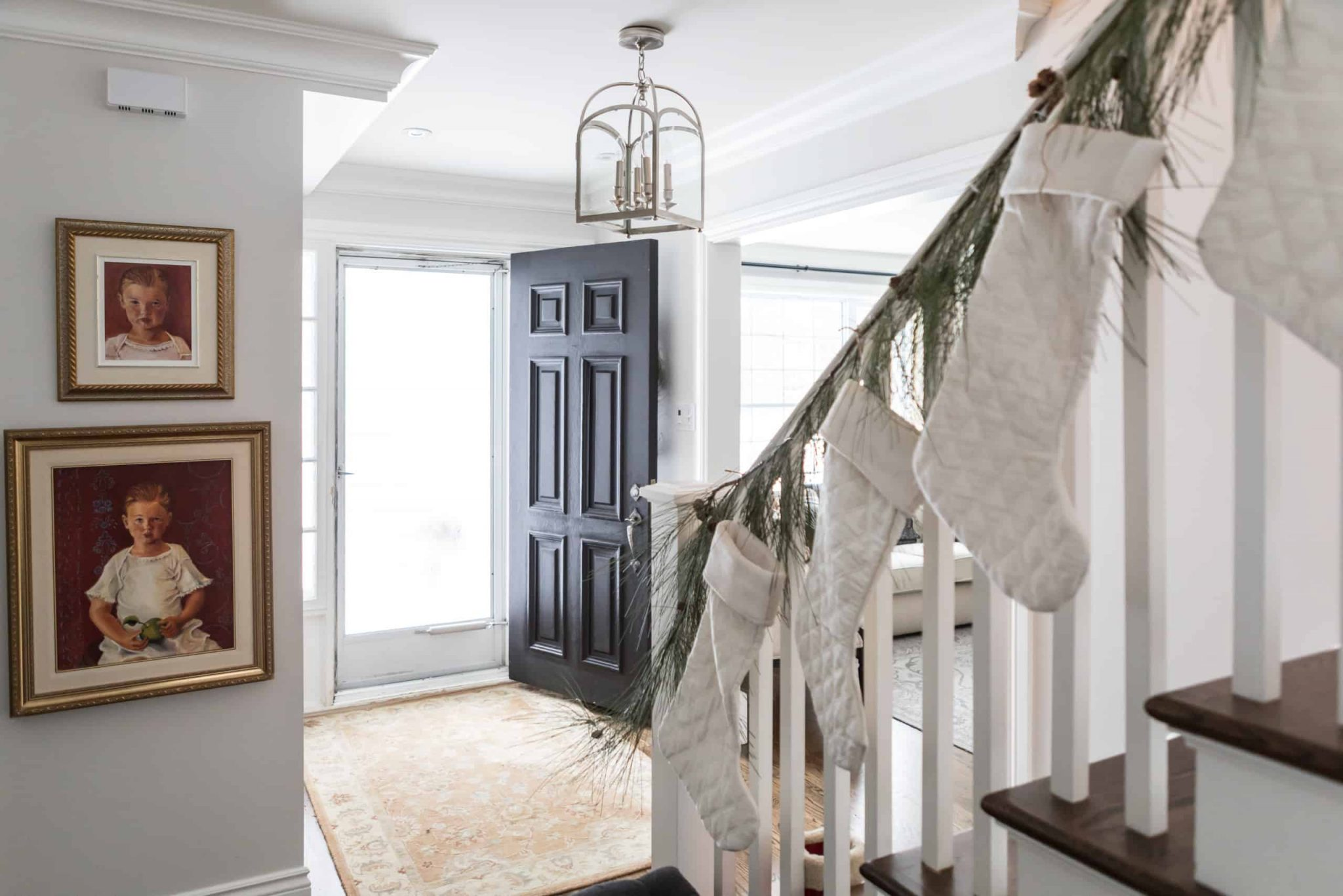 Modern staircase with white Christmas stocking's hanging of the railing