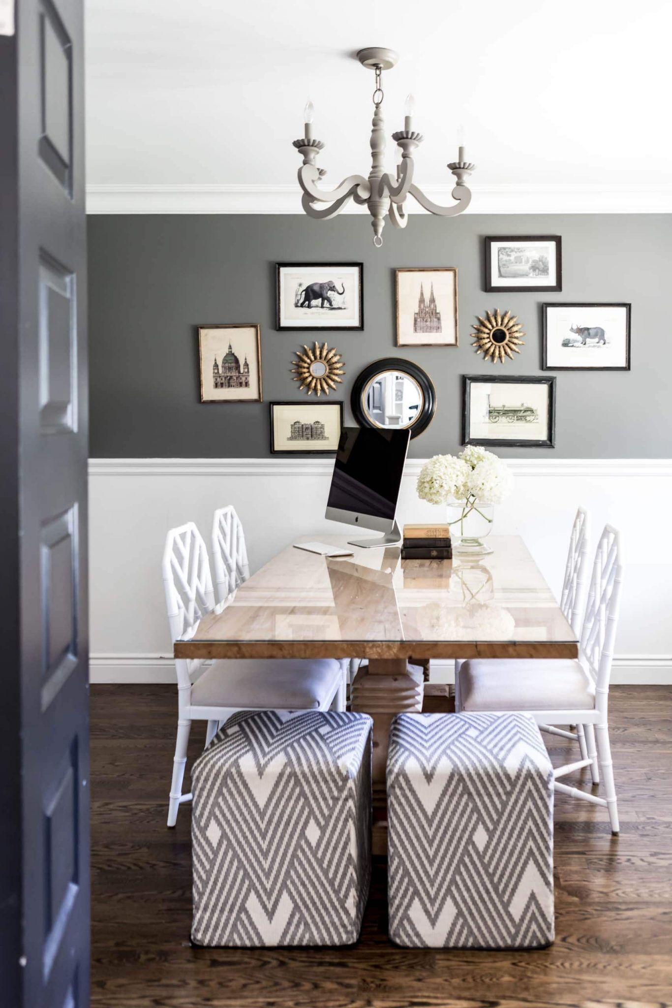 Black and white dining room with pictures of animals on the wall
