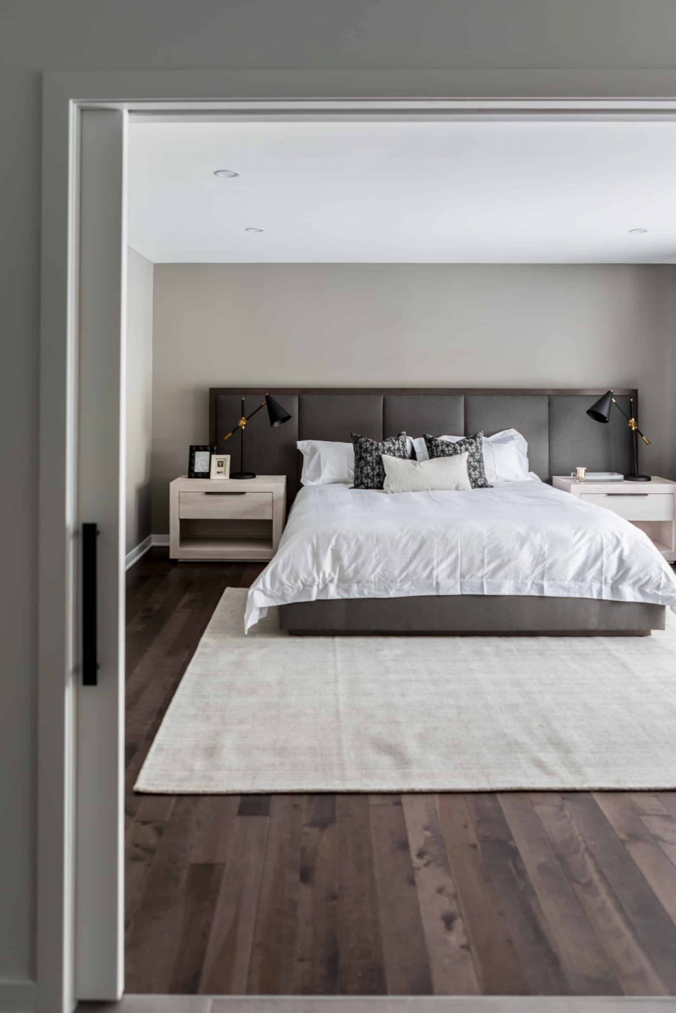 Large, open master bedroom with a massive bed