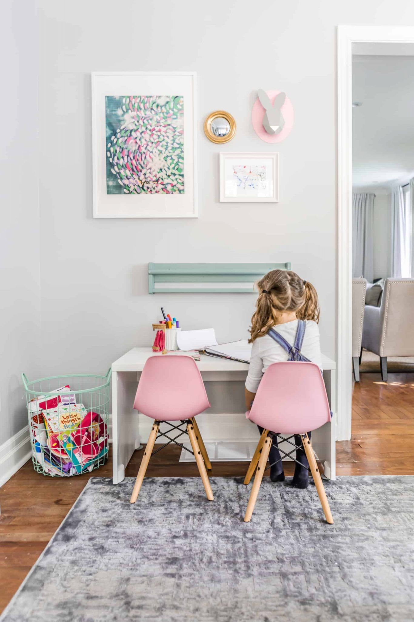 Small, pink stools at a small workspace
